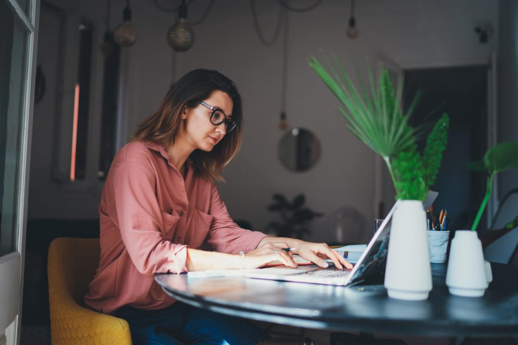 Woman working remotely using a laptop